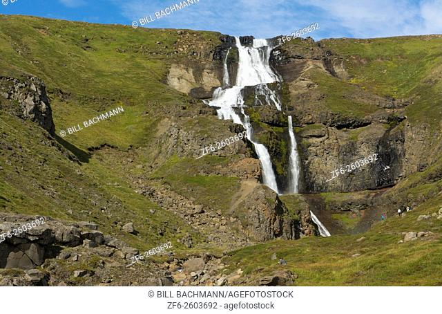 Iceland Rjukandi waterfalls in sunshine also called Yst i-Rjukandi with cliffs and waterfalls in Eastern Iceland near Egilsstadir on Ring Road