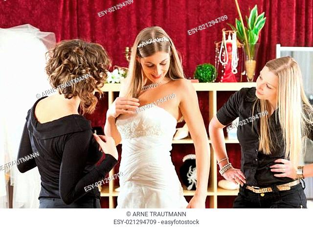 info for 77803 65873 Bride preparing for wedding with hairstylist Stock Photos ...