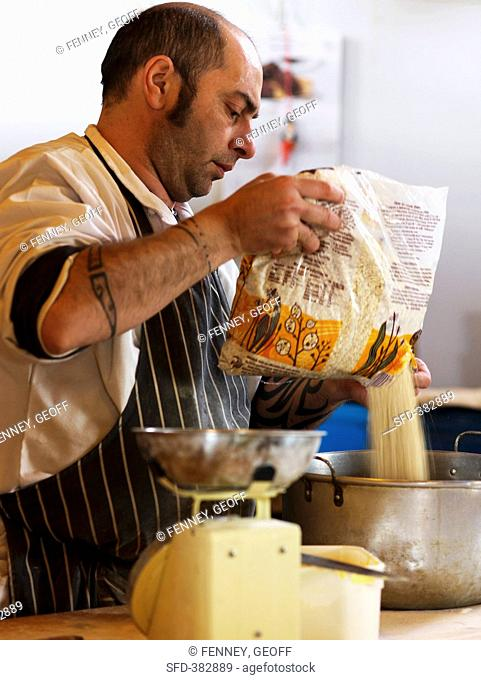 A baker making pancakes at a Farmer's Market in England