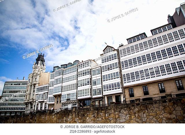 Traditional white wooden glazed windows in A Coruna, Galicia, Spain