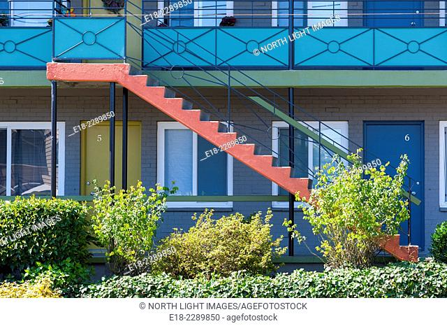 USA, Washington State, Seattle. Architectural detail of motel showing ground floor and brightly painted exterior stairway to the second level
