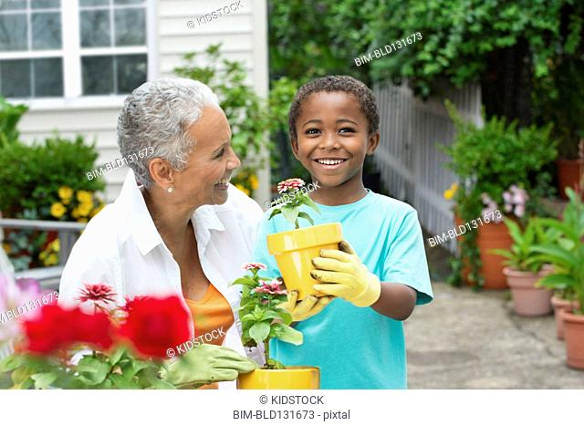 Senior woman and grandson gardening together