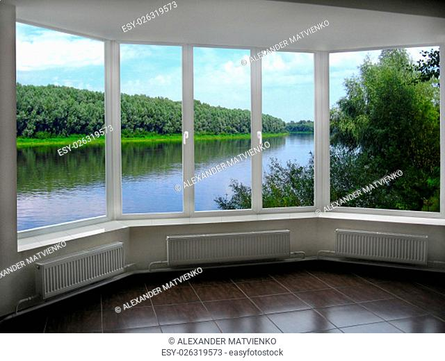 big windows with window overlooking the summer river and forest