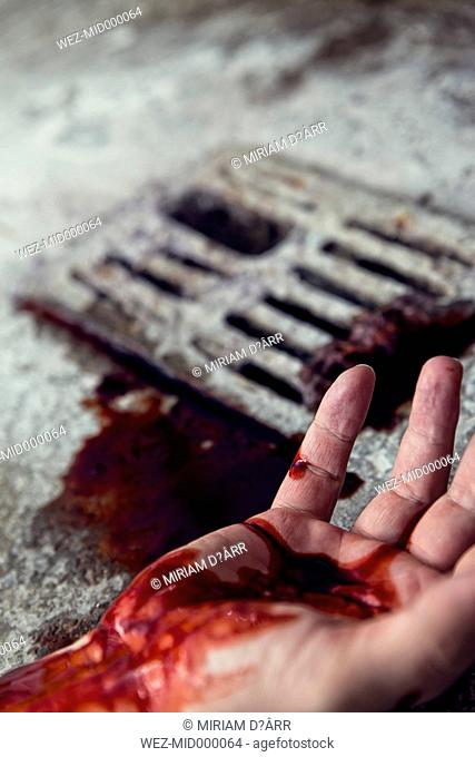 Blood-stained hand at gully