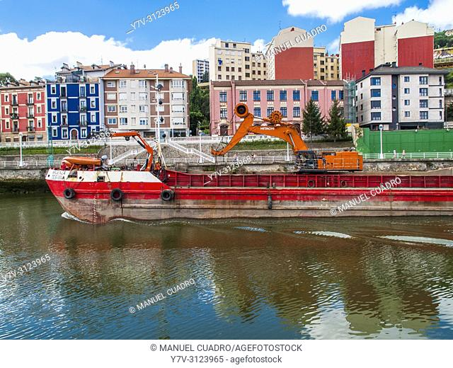 Dredger in Bilbao estuary, Olabeaga district, Bilbao, Biscay, Basque Country, Spain