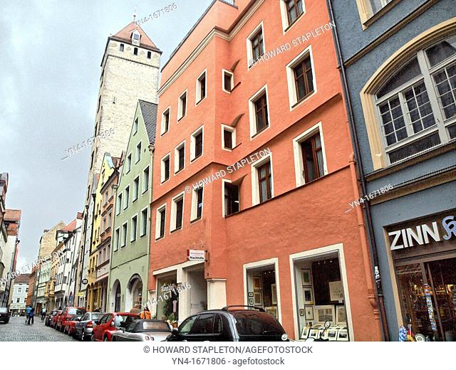 Wahlenstrasse in Regensburg, Germany  The tall building dates from 1260 and is known as the Golden Tower or the Goldener Turm  Originally part of a castle it...