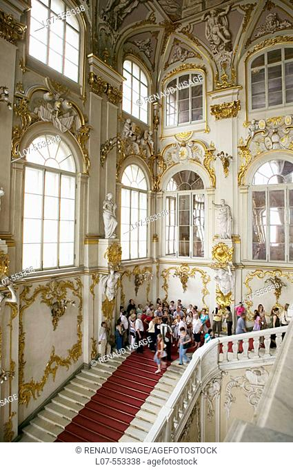 Tourists on the Jordan Staircase of the Hermitage Museum (Winter Palace). St Petersburg. Russia