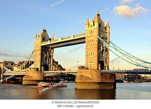 View from the south bank of the Thames towards the neo-Gothic bascule bridge, Tower Bridge, London, England, United Kingdom, Europe