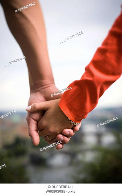 Close-up of a couple holding hands