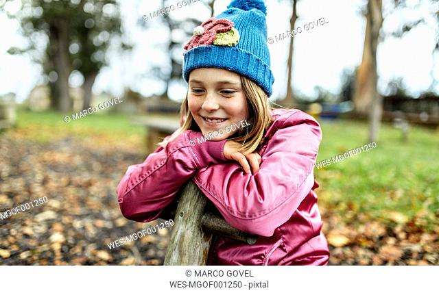 Portrait of happy girl on a playground in autumn