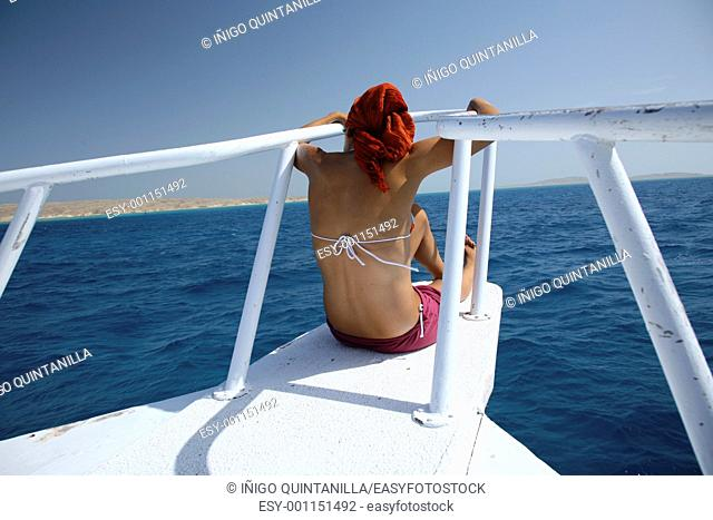 woman on the bow of a boat at red sea
