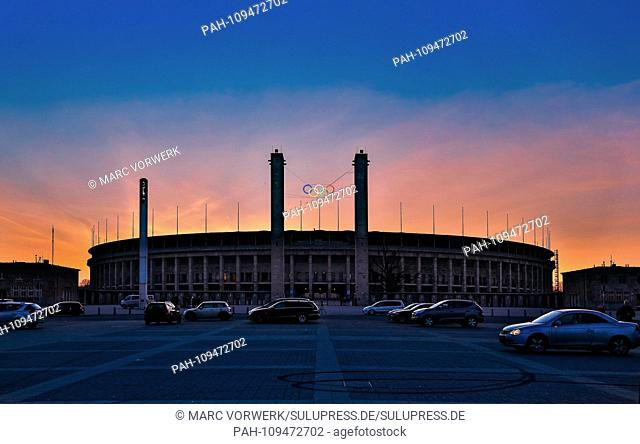 The Olympiastadion Berlin in the Berlin district of Westend in the dusk with a beautiful evening sky from the Olympic Square