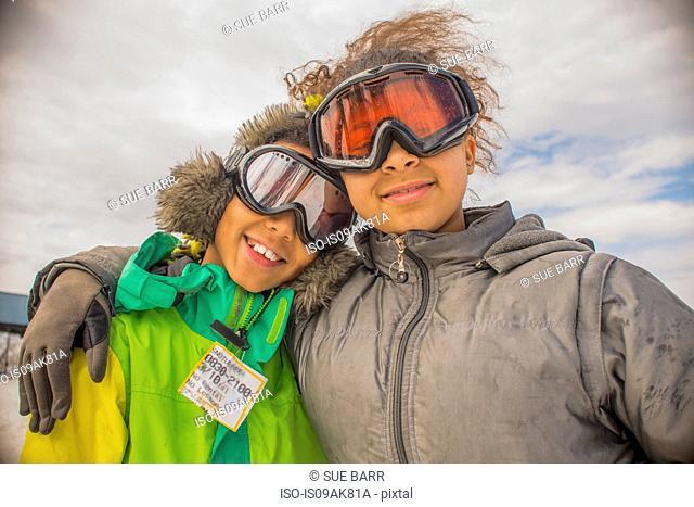 Portrait of children in ski goggles
