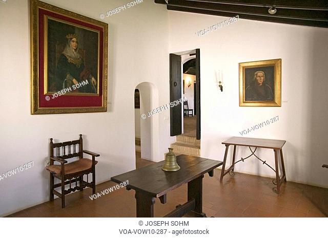Interior room with paintings of Christopher Columbus and his sponsor, Spanish Queen Isabella, as seen at the 15th-century Franciscan Monasterio de Santa María...
