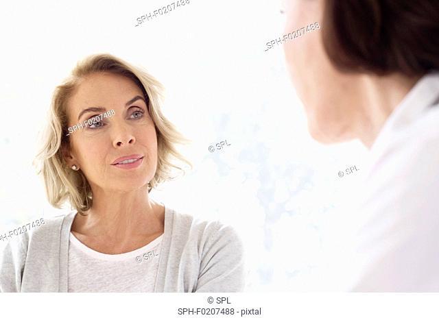 Mature woman listening to gp