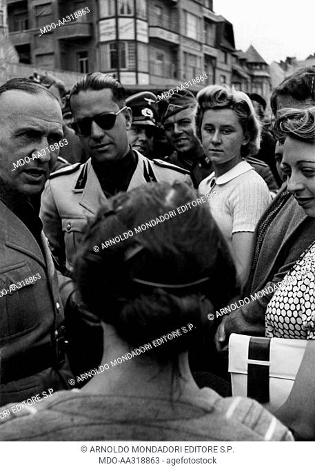 Galeazzo Ciano and Dino Alfieri among civilians and soldiers. Italian Ministry of Foreign Affairs Galeazzo Ciano and the Italian ambassador at Berlin Dino...