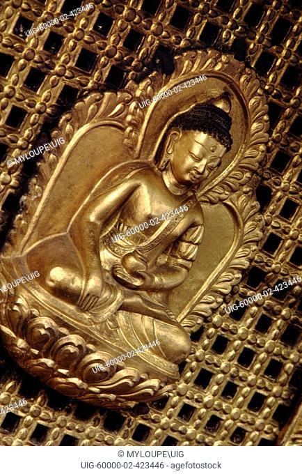 Gold gilded BUDDHA adorns a temple at SWAYAMBUNATH - KATHAMANDU, NEPAL
