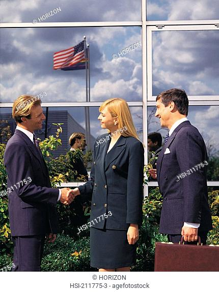 Side view of businesspeople handshaking in United Kingdom, Europe