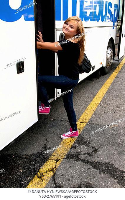 Last goodbye smile before long bus travel across Europe, here Geneva bus station, Switzerland, Europe