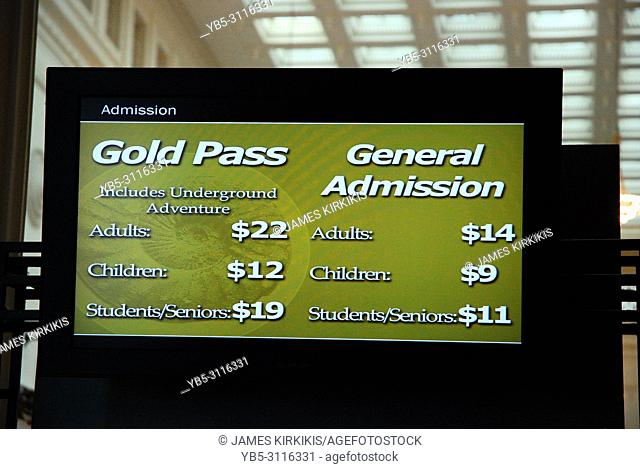 A video display board tells of the admission fees to a museum