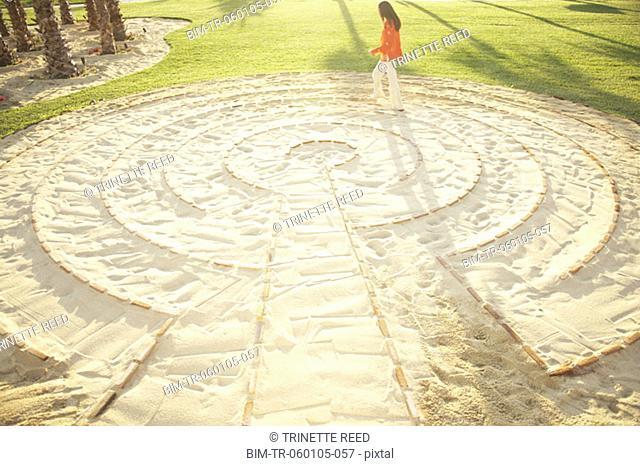 Woman walking in a meditation labyrinth