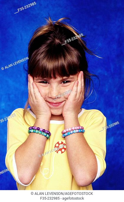 Smiling Girl with Bead Bracelets