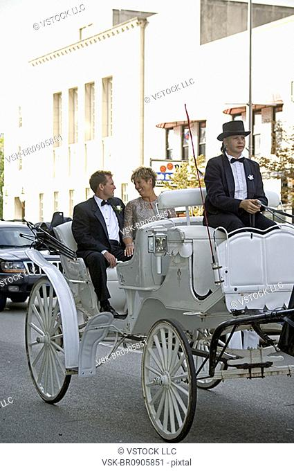 Couple on horse and carriage ride