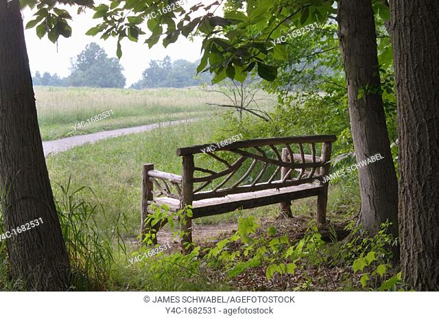 Bench in Poets' Walk Romantic Landscape Park in the Hudson Valley at Red Hook, NY