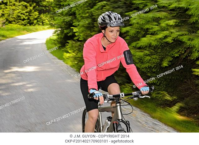 Woman mountain biking motion blur cycling path training race
