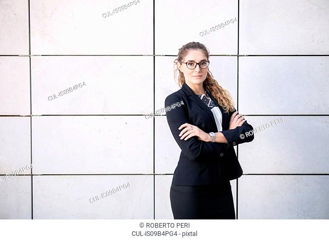 Portrait of young businesswoman, arms folded