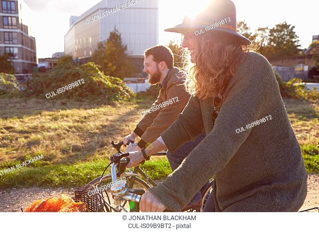 Couple enjoying cycling on marshes