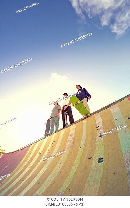 Men standing on ramp at skate park