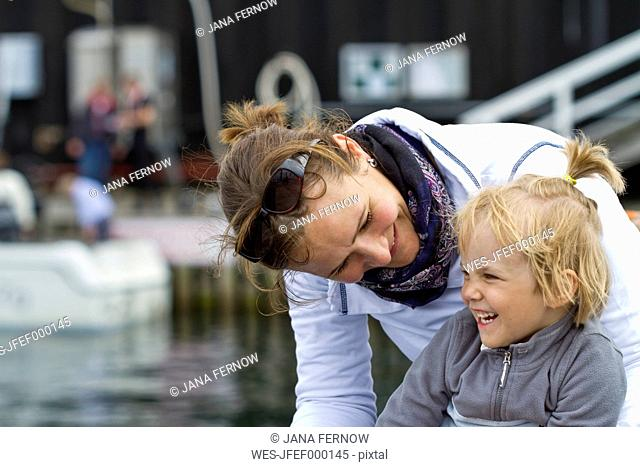 Germany, Kiel, Girl laughing with her mother