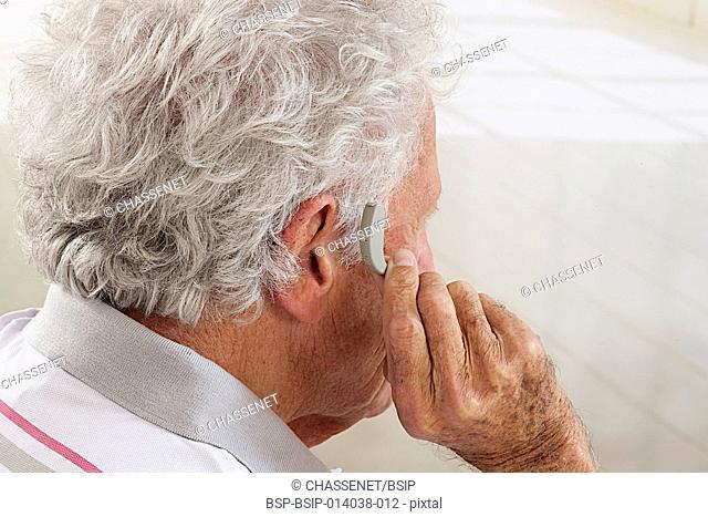 Senior man wearing a hearing aid