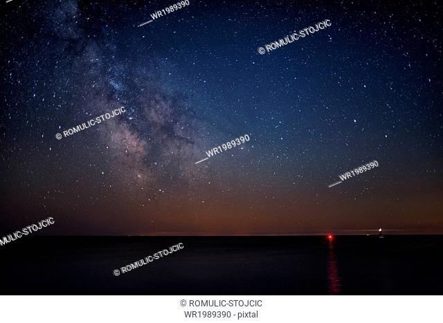 Starry night sky over seascape
