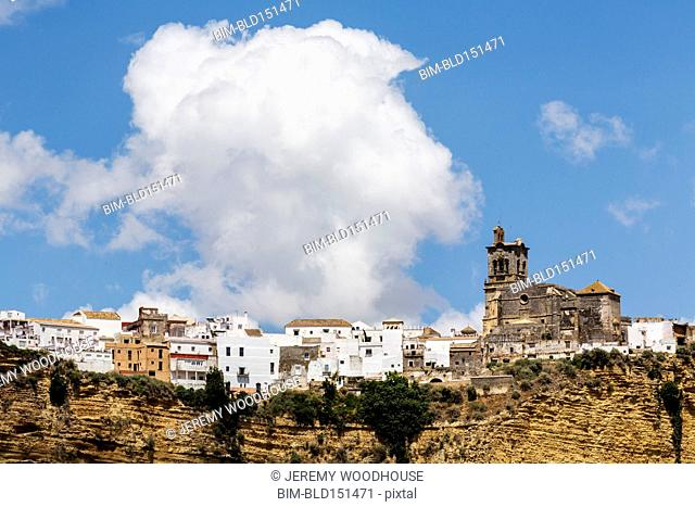 Church and village on cliffside, Arcos de la Frontera, Andalusia, Spain