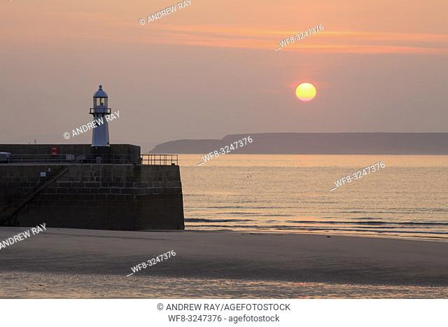 The lighthouse on Smeatons Pier at St Ives on the North coast of Cornwall, captured using a telephoto lens on a morning in early May