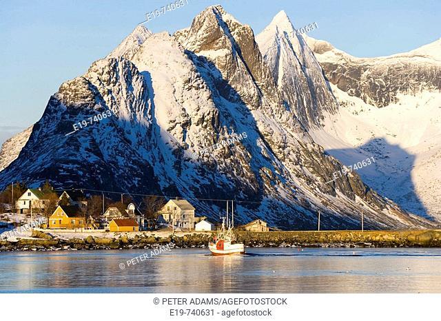 Fishing boat & Reine Village, Lofoten, Norway
