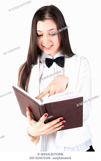 Portrait of pretty student or businesswoman in smart casual reading organizer over white background