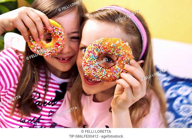 Girls during birthday party with donut