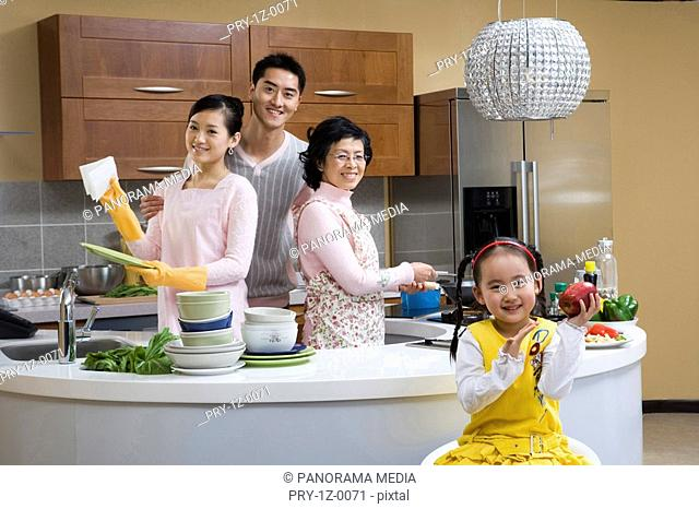 Family busying in kitchen