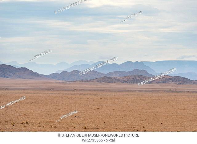 Namibia, Hardap, Sesriem, hilly landscape of the desert in the rainy weather
