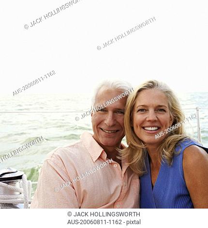 Portrait of a mature couple smiling together in a boat