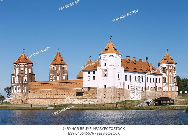 Mir, Belarus. Scenic View Of Mir Castle Complex From Side Of Lake. Architectural Ensemble Of Feudalism, Ancient Cultural Monument, Unesco Heritage