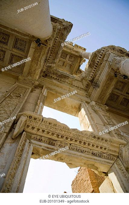 Ephesus. Roman Library of Celsus facade. Angled view looking up at decoratively carved roof and doorway