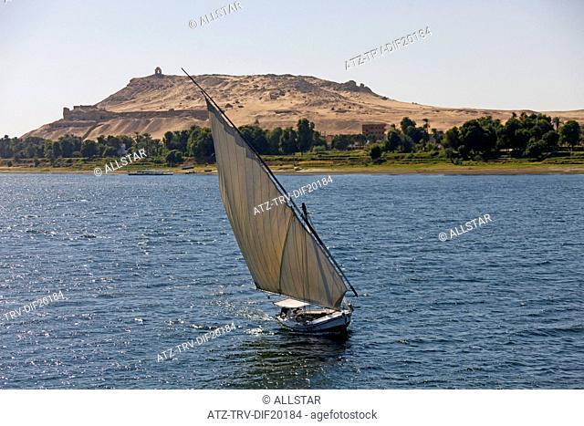 FELUCCA IN FULL SAIL & TOMB OF NOBELS; RIVER NILE, ASWAN, EGYPT; 10/01/2013
