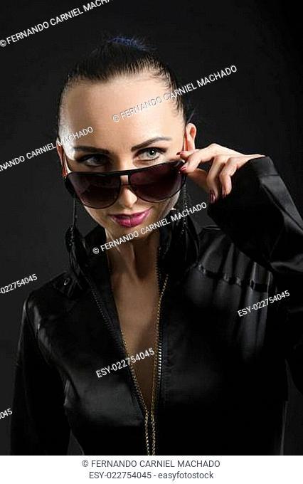Pretty Caucasian woman in black leather catsuit