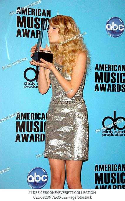 Taylor Swift (wearing a Collette Dinnigan dress) in the press room for American Music Awards 2008 - PRESS ROOM, NOKIA Theatre LA LIVE, Los Angeles, CA