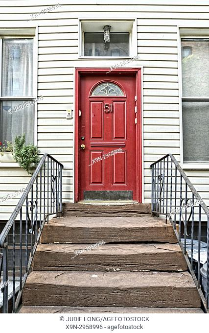 Brooklyn, NY, Greenpoint. Close-up of a Red Entry Door on a Typical Wooden Home