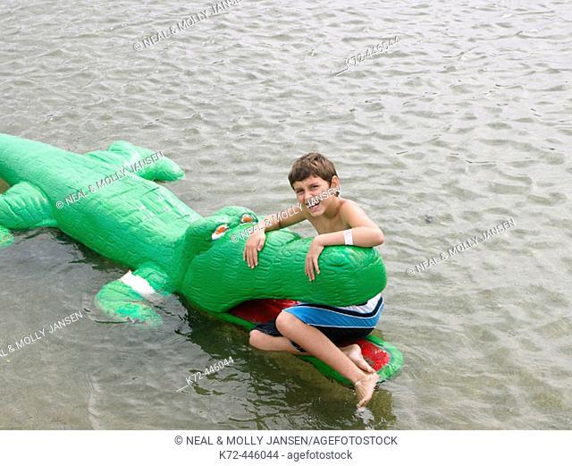 Boy sitting in alligator mouth
